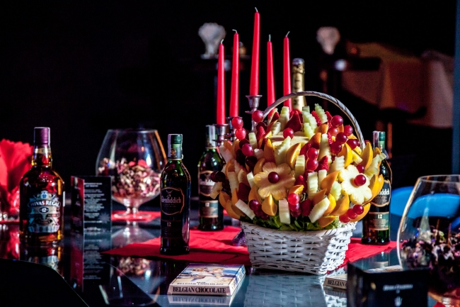 Celebrating Happy New Year with Edible Fruit Arrangements as a centerpiece on the table.